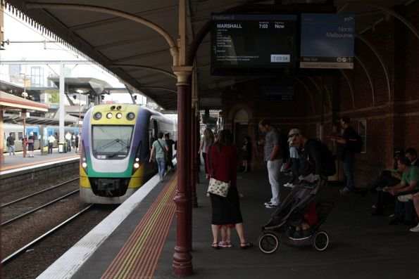 Marshall service led by VLocity 3VL36 picks up passengers at North Melbourne station