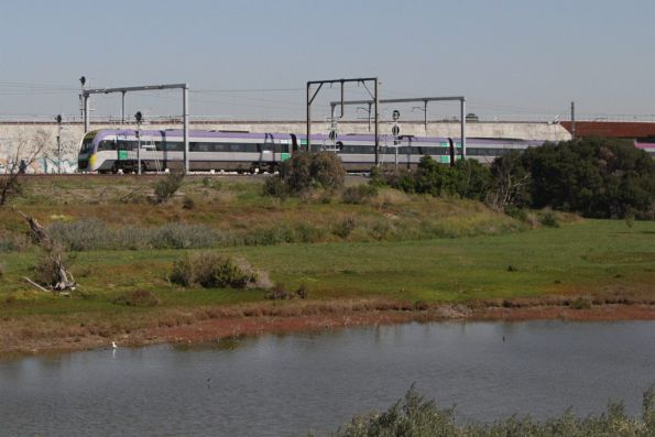 VLocity heads towards Southern Cross on the suburban tracks near the Maribyrnong River bridge
