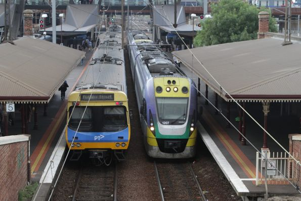 VLocity VL07 and classmate pass through the suburban platforms at North Melbourne with a down Seymour service