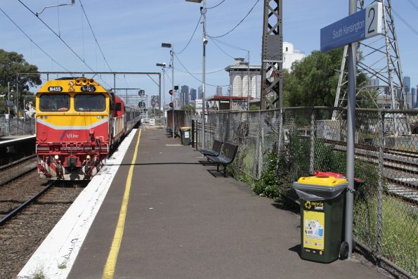 N455 leads a down Geelong service along the suburban tracks at South Kensington