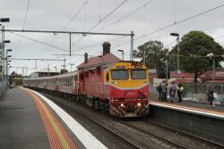 N475 leads an up Geelong service at Yarraville