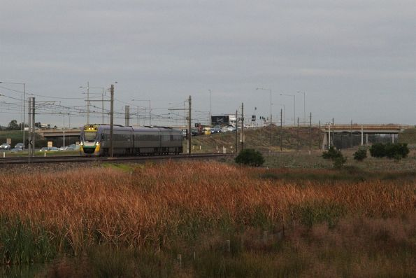 Solo 3-car VLocity leads an up Geelong service past the wetlands at Williams Landing