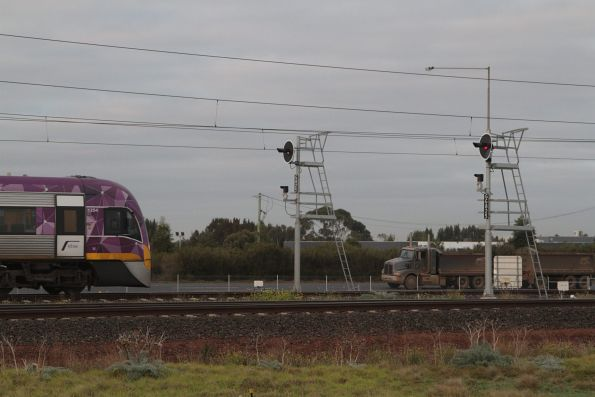 VLocity 3VL54 with a down Geelong service crawls along the Werribee line on orange signals