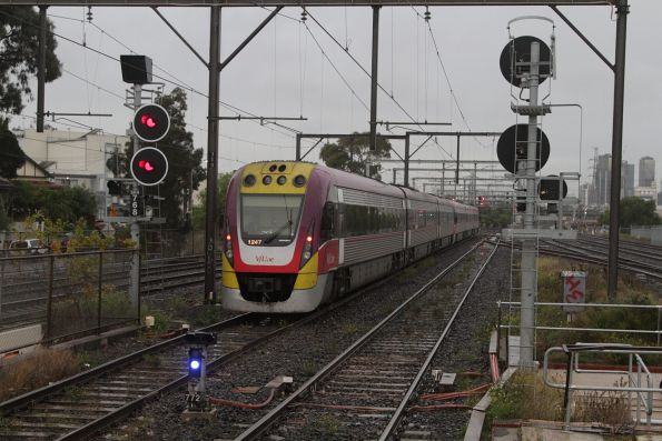 VLocity 3VL57 trails an up Geelong service at South Kensington, about to diverge onto the RRL tracks