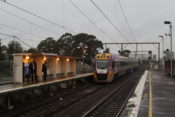 VLocity 3VL56 leads an up Geelong service towards the RRL tracks at South Kensington
