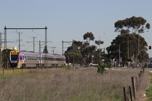 VLocity 3VL01 on a down Bendigo service crosses the soon to be removed Ginifer Road level crossing at Ginifer