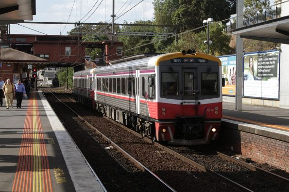 Sprinter 7016 and classmate pass through North Melbourne with an up Seymour service