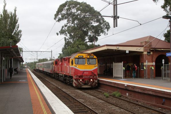N474 leads the down Shepparton service through Newmarket