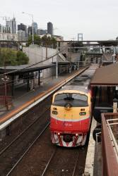 A66 leads a down Seymour service at North Melbourne