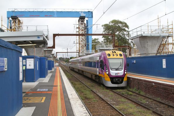 VLocity VL63 passes under the massive gantry crane at Murrumbeena station
