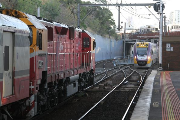 N470 arrives at North Melbourne with an up Shepparton service, with VLocity VL14 arriving on a down Seymour service
