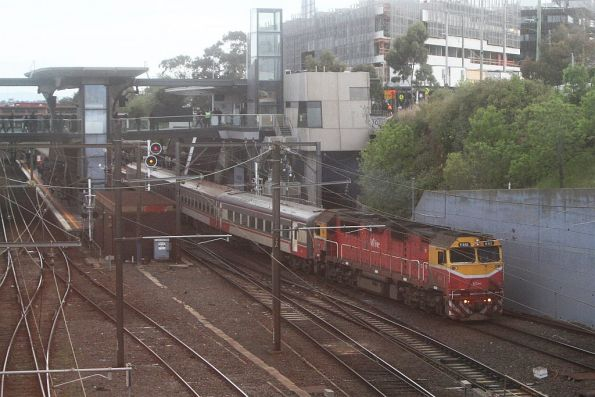N461 leads an up Seymour line service out of North Melbourne station