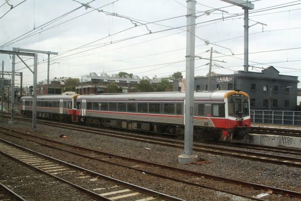 Pair of Sprinters on an up Seymour service wait at North Melbourne for a path into Southern Cross