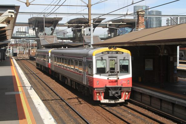 Sprinter 7014 and classmate arrive at North Melbourne with a down Seymour service