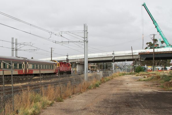 N class leads the up Swan Hill service under the Melton Highway bridge at Sydenham
