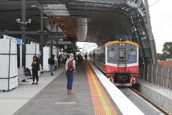 Sprinter 7022 and two classmates arrives at the new elevated Clayton station with a down Traralgon service
