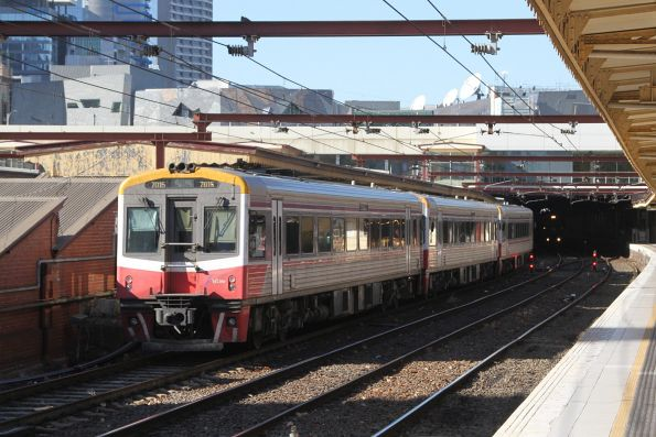 Sprinter 7015 trails two classmates into Flinders Street Station with a down Traralgon service
