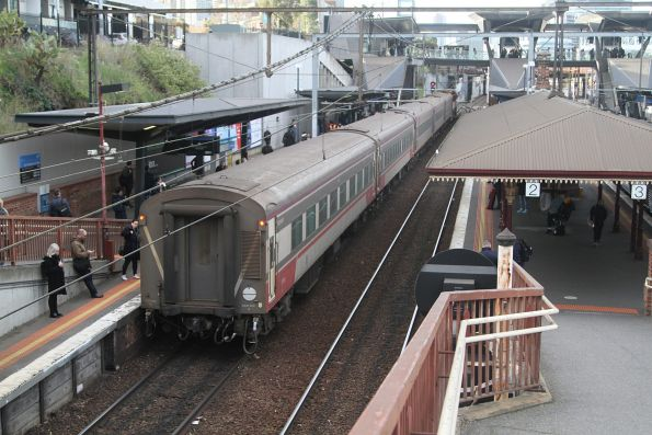 Up Shepparton service departs North Melbourne platform 1