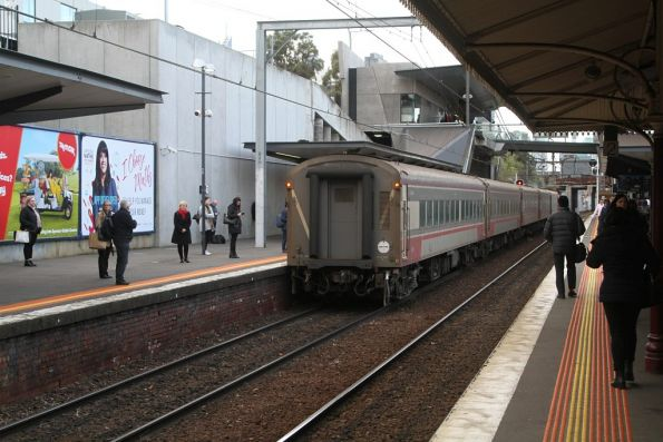 Up Shepparton service departs North Melbourne on the up
