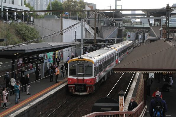 Sprinter 7016 trails 7007 and classmate into North Melbourne on an up Seymour service
