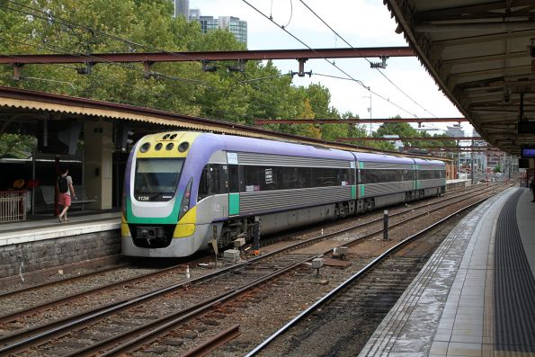 VLocity VL36 p[asses through Flinders Street platform 10 on an up Gippsland service
