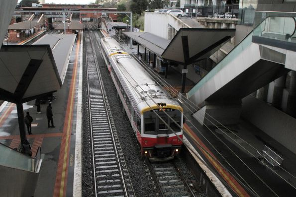 Sprinter 7011 and classmate on an up Seymour service at North Melbourne