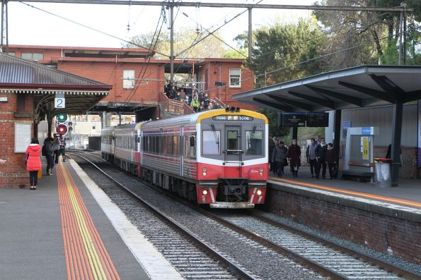 Sprinter 7006 and two classmates arrive into North Melbourne on an up Seymour service