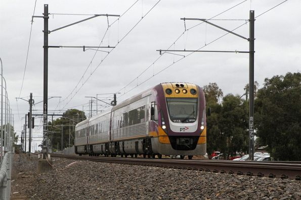VLocity VL15 on an up Bendigo service crawls along behind a all stations suburban service at Keilor Plains