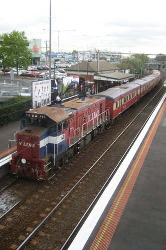 P15 trails a morning commuter train at Footscray