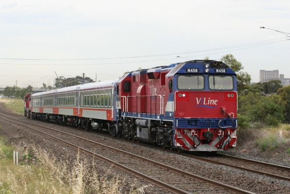 N458 leads N451 push-pull and four cars of carriage set VN12 in the new V/Line livery on a test run to Geelong