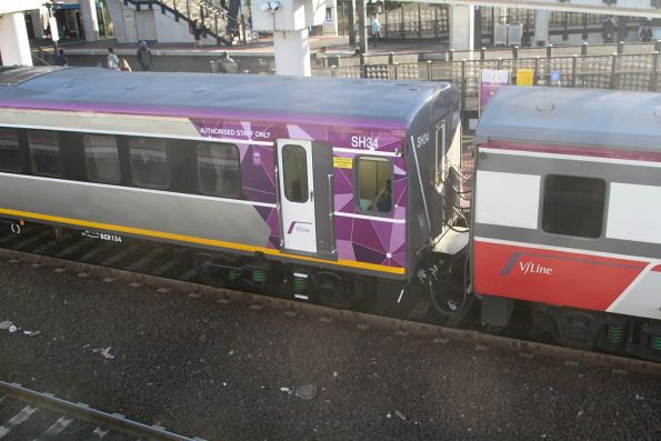 PTV livery carriage set SH34 coupled to a set still in Mk3 livery