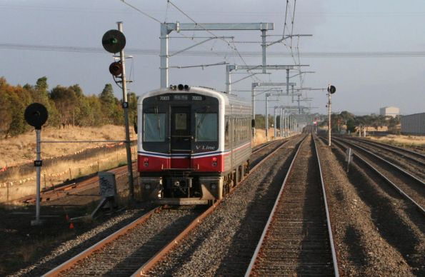 Sprinter 7003 on a down Seymour service departs Somerton