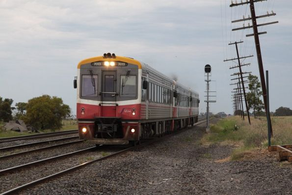 Sprinter 7013 leads two classmates on a down Seymour service at Summerhill Road, Craigieburn