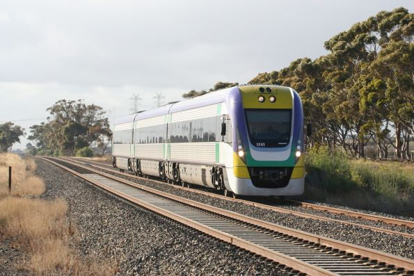 Three car VL41 leads a local service to Sunbury past Calder Park