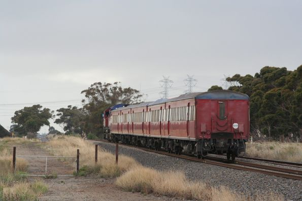 N467 leads a local service from Sunbury outside Calder Park Raceway