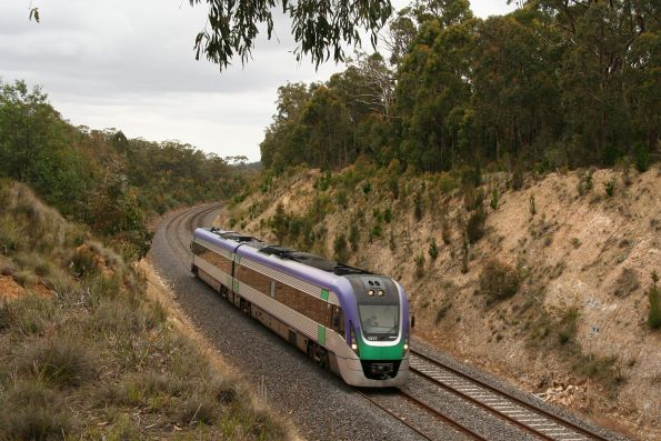 VLocity VL17 heads through the forest between Macedon and Woodend