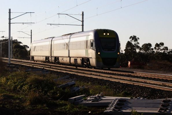 A solo VL12 on the up beneath the overhead at Holden Road, Calder Park