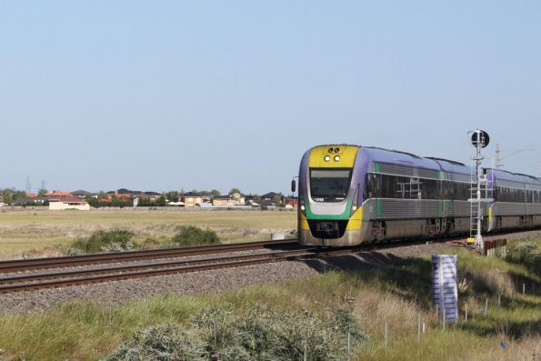 Leaving the suburbs behind, VL08 approaches Calder Park Drive on the down