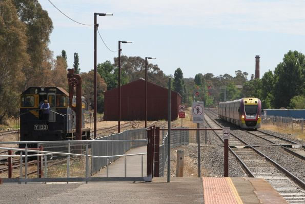 VLocity train arrives into Castlemaine, Y133 on the Victorian Goldfields Railway tracks alongside