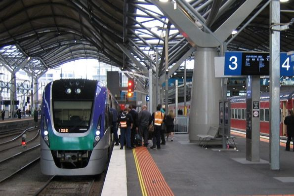 Passengers wait to board VLocity VL32 at Southern Cross
