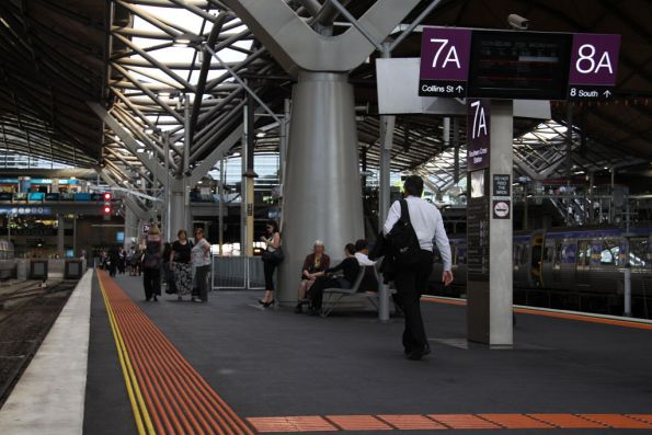 Passengers waiting for their train on platform 7A, five minutes until departure and it is yet to dock