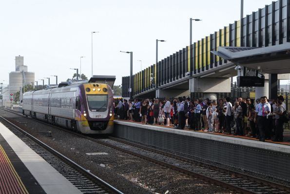 VLocity 3VL40 on a down Bacchus Marsh service arrives into a platform crowded with abandoned Wyndham Vale passengers at Sunshine