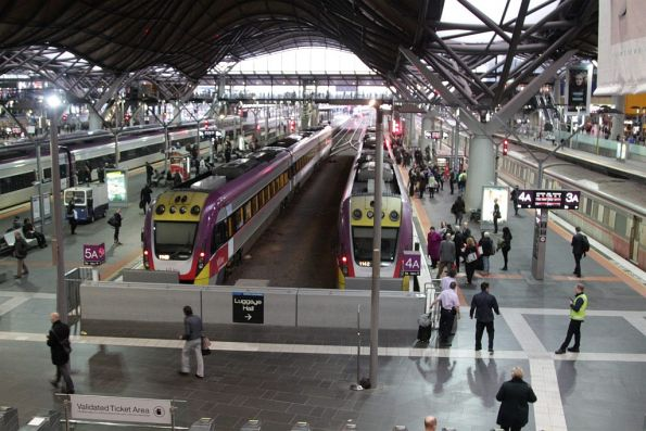 Crowd of V/Line commuters await boarding time at Southern Cross Station