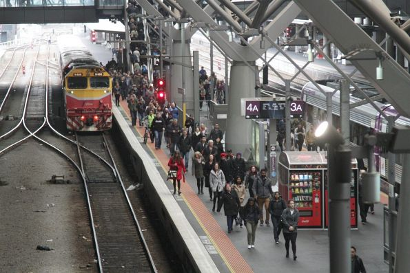 After their train arrives at Southern Cross V/Line passengers take a long walk towards Collins Street