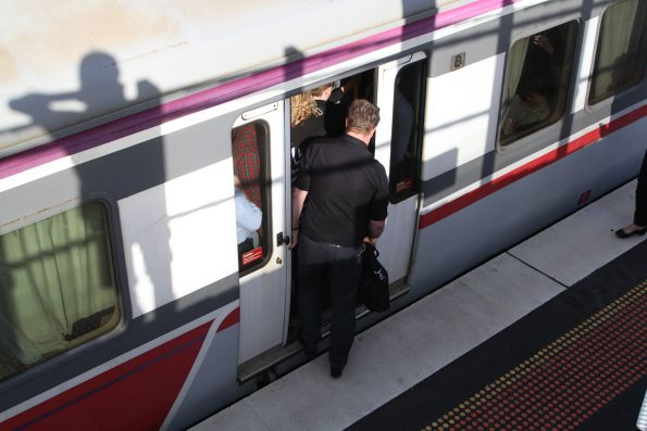 Passengers struggle to board a crush loaded Bacchus Marsh bound service at Sunshine