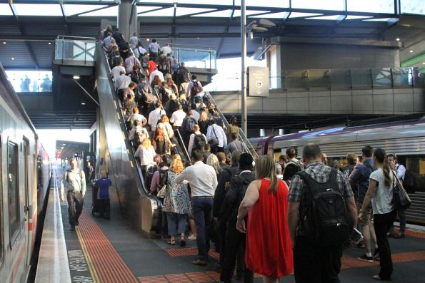 V/Line passengers crowd the escalator between platform 3/4 and the Bourke Street bridge