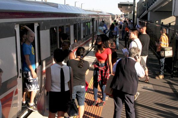 Confused passengers try to board an overcrowded V/Line service at Sunshine in evening peak