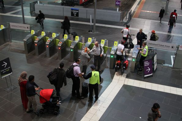 Crowd of passengers needing help at the entrance to the country platforms at Southern Cross Station