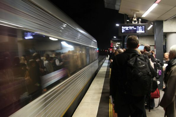 Down Wendouree service skips the station at Sunshine, despite a crowd of waiting passengers