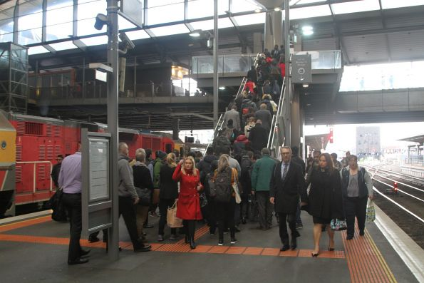 Single set of stairs isn't enough to handle passengers exiting a train at Southern Cross platform 8